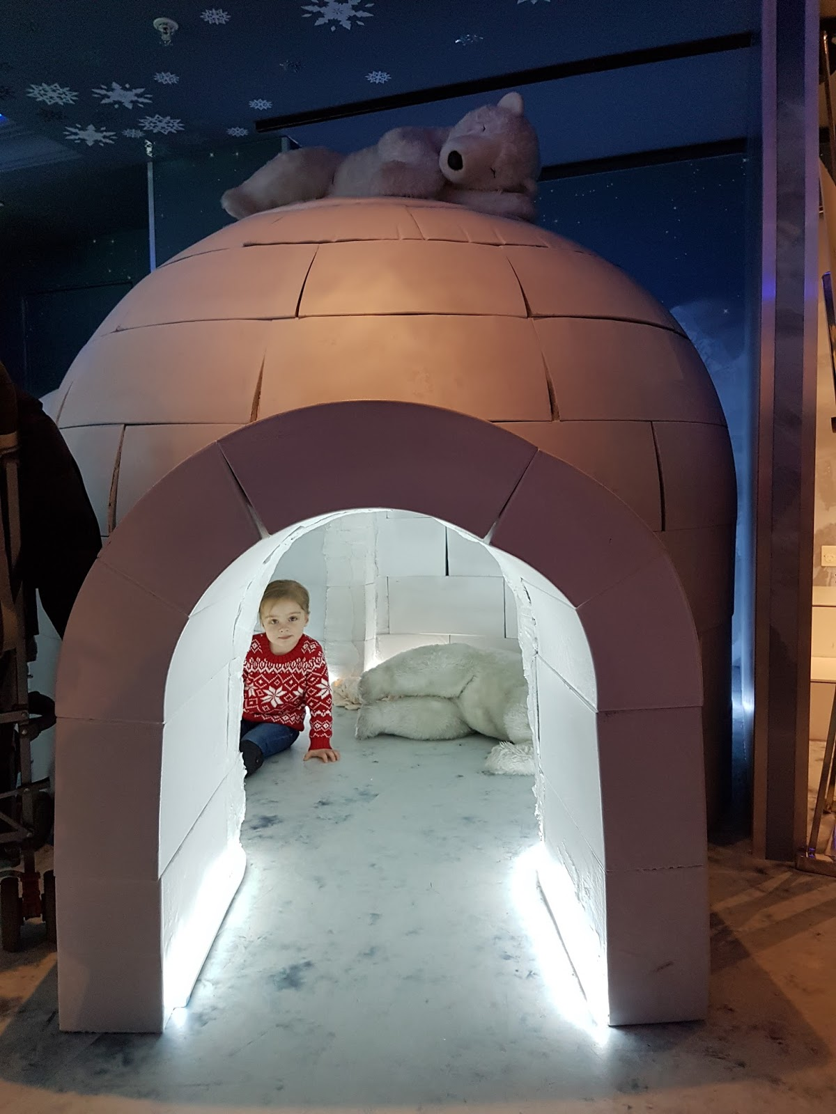 girl inside an igloo at harrods christmas grotto 2016