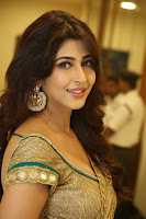 Sonarika Looks amazing Sizzling Cute in a Lovely Golden Choli Saree at eedo rakam aado rakam audio release function