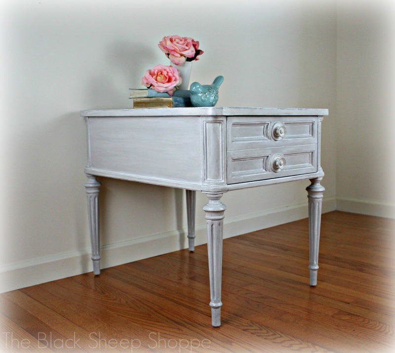 Side view of Drexel Classic Treasury end table.