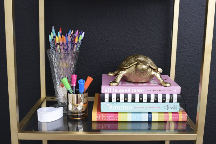 A glam and gold home office featuring office supplies and decor from Target. The gallery wall is functional and pretty!