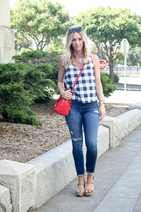 blue and white checked tank jeans red handbag