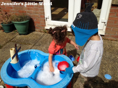 Children playing at water table