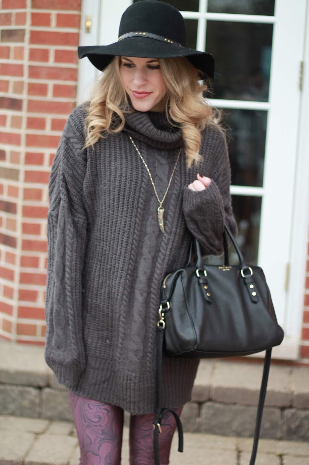 burgundy printed leggings, tunic sweatshirt, taupe slip ons, grey cable knit tunic, black booties, kate spade black crossbody bag, black floppy hat