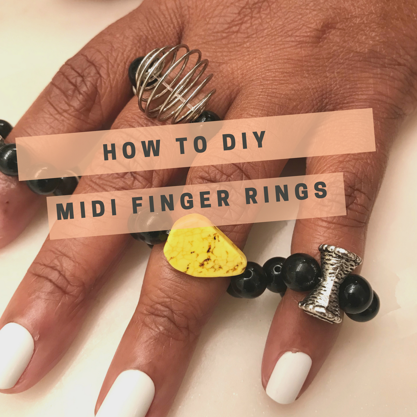 Image: Hand wearing midi finger rings