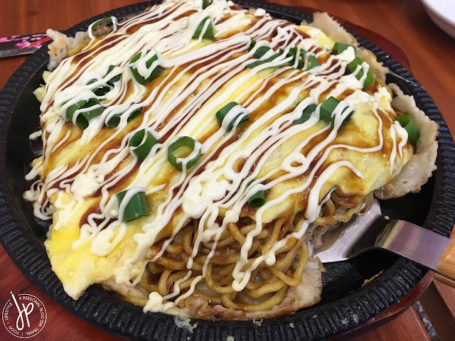 scrambled egg omelette with noodles, sauce, and mayonnaise