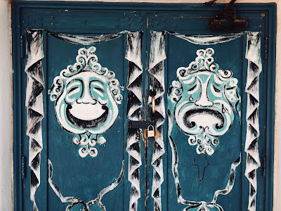 Mask design on the doors of Amargosa Opera House Theater.