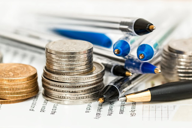 Photo of coins, pens, and paper