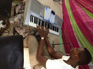 man playing what a friend we have in Jesus on the piano