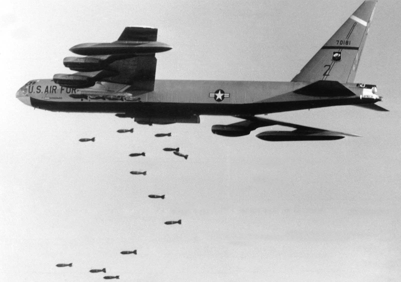 A strategic air command B-52 bomber with externally mounted, 750-pound bombs heads toward its target about 56 miles northwest of Saigon near Tay Ninh on November 2, 1965.