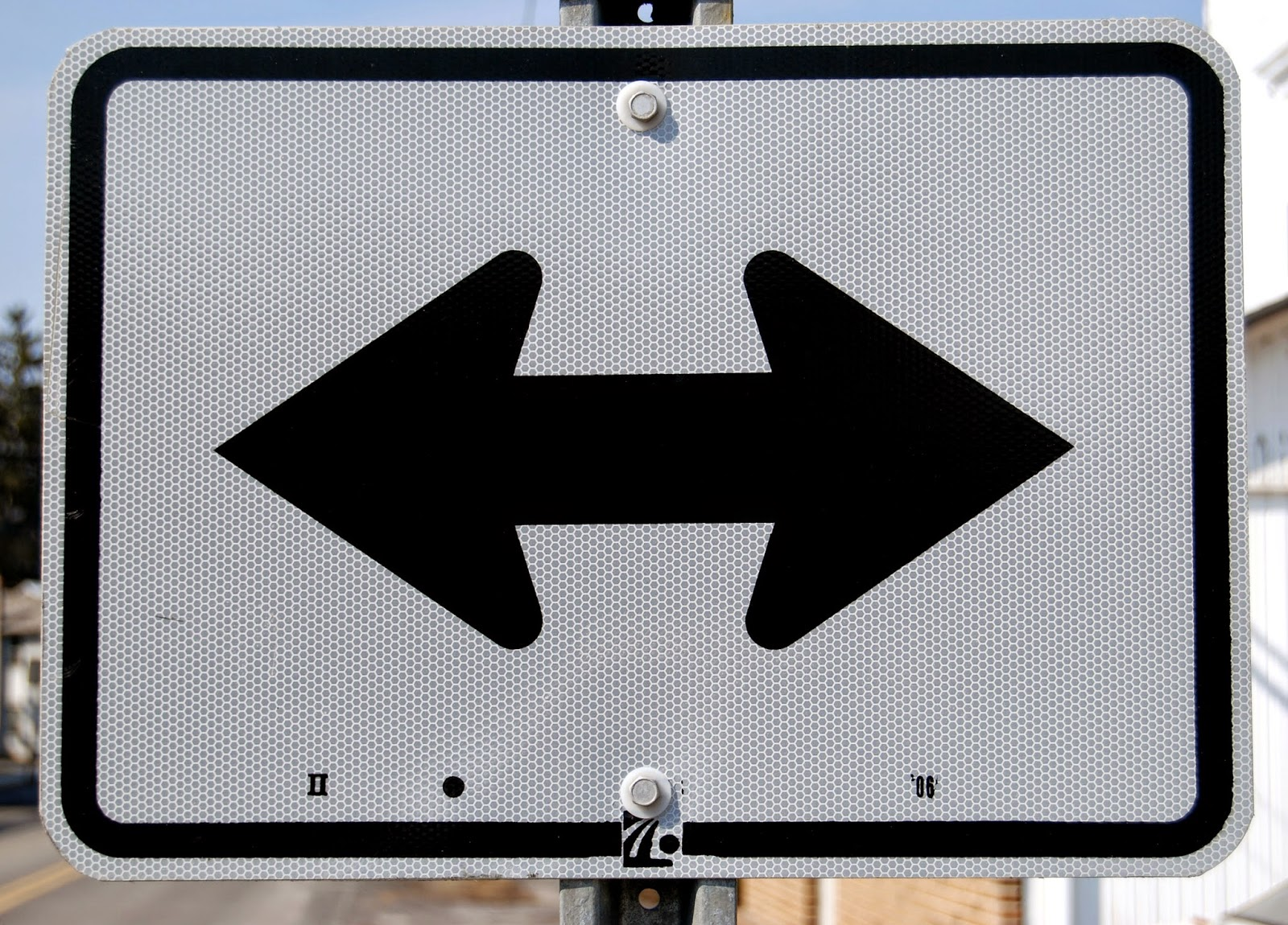 sign pointing to two different directions. Crossroads