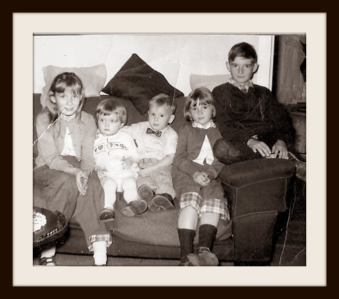 My sisters, my brother, a cousin, and me in 1958