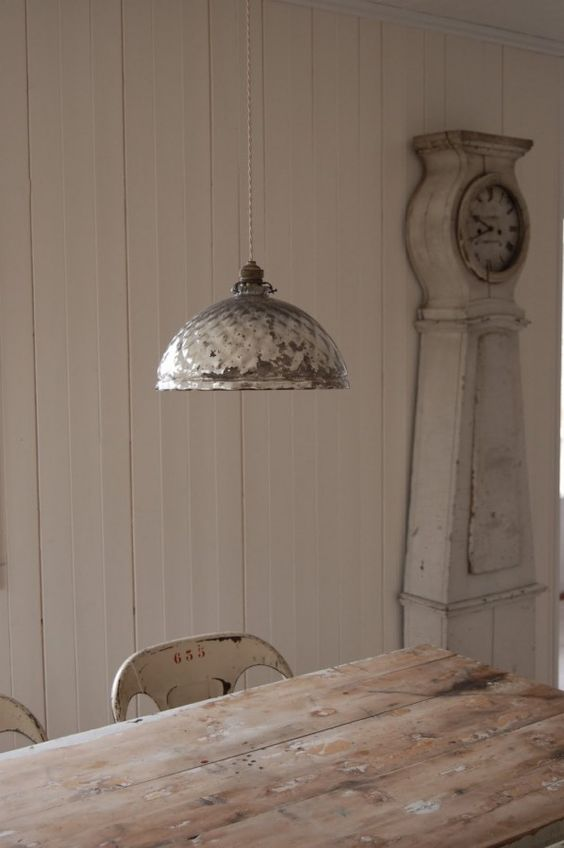 Modern country Swedish style dining room with rustic table and Mora clock - found on Hello Lovely Studio
