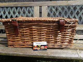 hamper basket closed on bench in sunshine