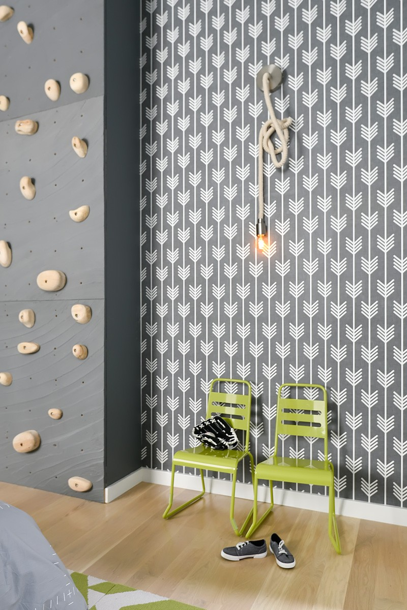 Wallpaper and rock climbing wall in modern home Church conversion to chic private home