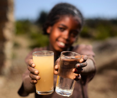 Children taking clean water and dirty water