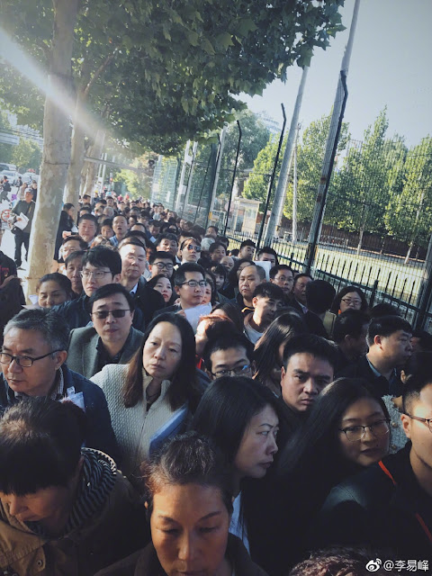 Li Yi Feng waits in line for embassy