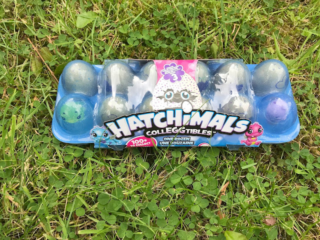 Hatchimals CollEGGtibles one dozen eggs packet on grass