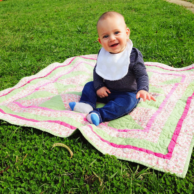 My second son sitting on a rug - smiling away {making a liar of me}