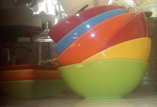 stack of plastic bowls from India, different colors