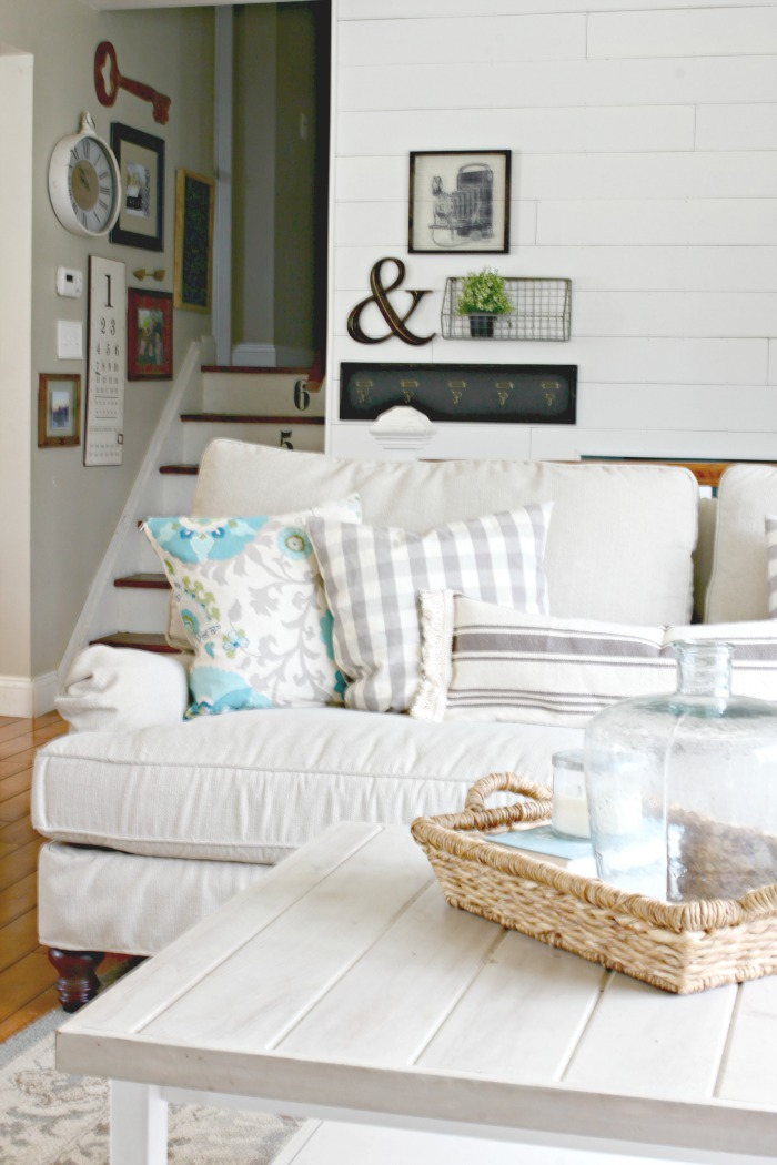 Spring decor in living room with wall planking and gallery wall - www.goldenboysandme.com