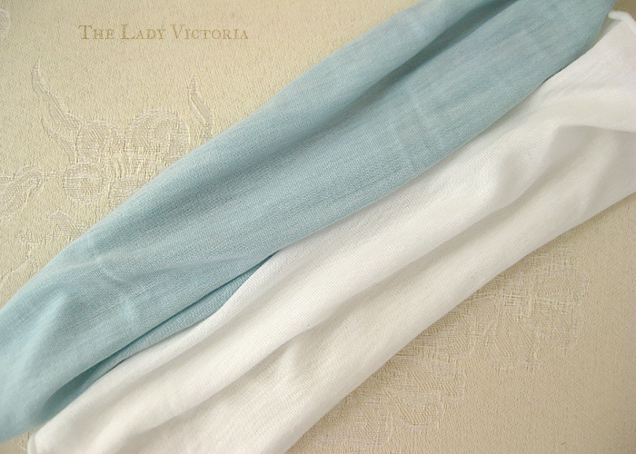 bleached white knit fabric next to blue knit fabric