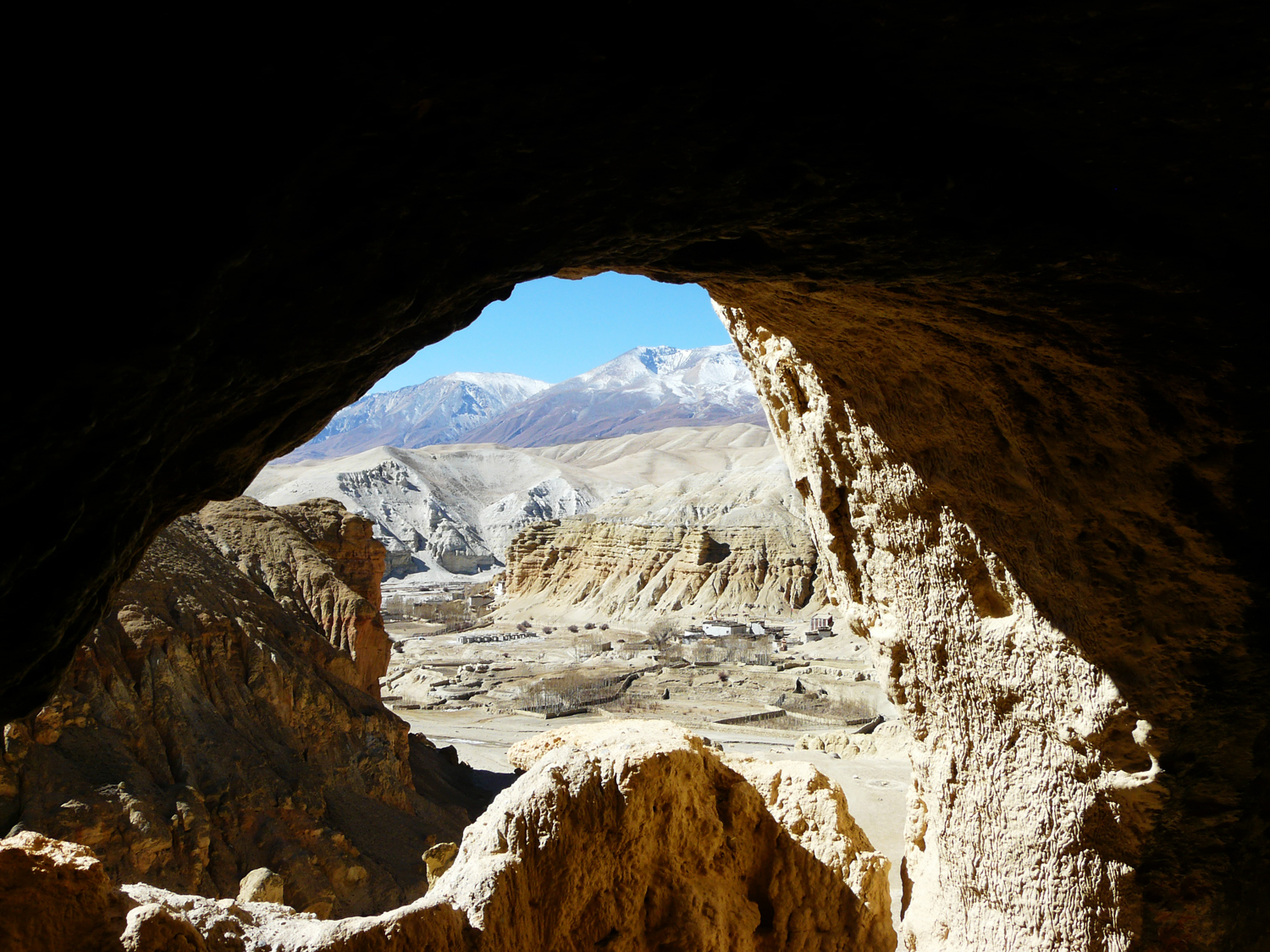 One of the World's Greatest Archaeological Mysteries has been Discovered Deep within the Himalayas in Nepal Lo-manthang-seen-from-inside-high-cave-upper-mustang