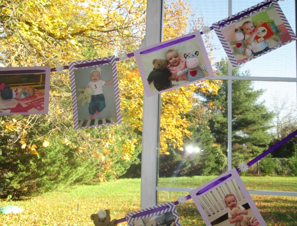 using monthly baby pictures to make a photo banner for a first birthday party