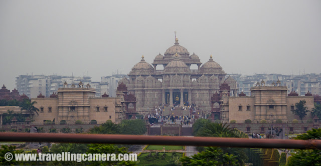 Photography and shooting videos inside Metro is not allowed but one can click photographs of things outside Metro... Many times I see beautiful Akshardham Temple from Metro and since Cameras are not allowed inside, I thought of capturing it through Metro only ...A quick glance at Akshardham Temple from Metro train at Delhi, INDIA !!! Although these pics are shaky...Flyovers near Akshardham temples have made drive easy for people who come via cars... All thanks to Common Wealth Games. Although many corrupt people dumped our money at unknown places, but infrastructure has improved a lot !!!Anyway, speed of improving infrastructure is less than population of our country !!! So this photograph shows heavy jam on same flyovers which helped in reducing traffic during Common Wealth Games .... Same thing is with Metro train.. Initially everyone thought that it will reduce some traffic on roads, but now Metro is also overloaded as we see Delhi-Roads...Anyways Akshardham is a lovely place and good place to hang out with your family and friends... I always recommend light and music fountain show which happen during evenings.. It's amazing and should be seen once at least....