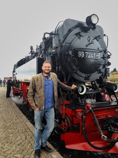 The Social Traveler with the steam train at Brocken the top of the Harz mountains