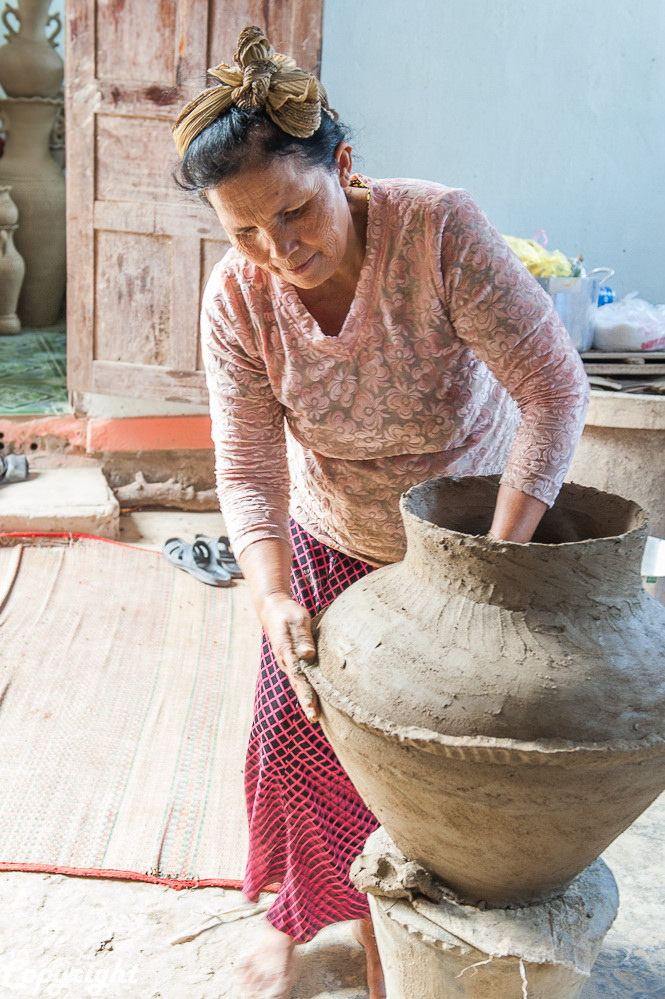 Vietnamese Cham woman working on creating a jar