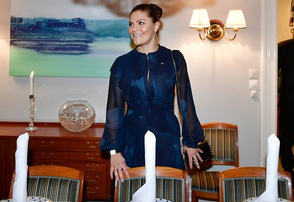 Crown Princess Victoria wore StarStudio PR Baroque pearl earrings, a new printed dress by Rodebjer. HM Dark blue dress
