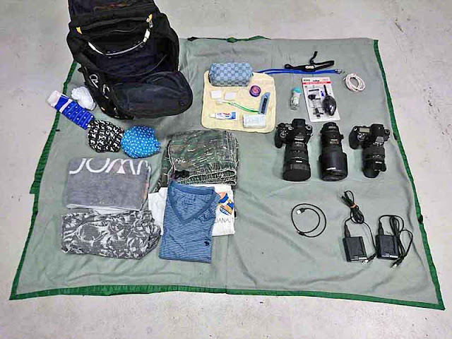 pack, cameras, lenses, chargers, USB for smartphone, clothing