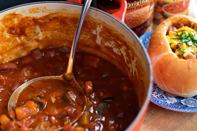 The finished chili, in the pot, and in a bread bowl beside it.