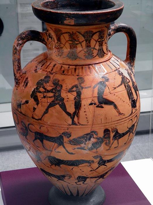 En la decoración de esta antigua ánfora griega se pueden observar atletas practicando el salto de longitud y otras disciplinas, al igual que en las ánforas halladas en la tumba del Atleta de Tarento.