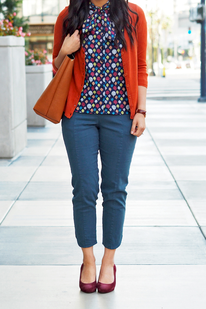 printed top + orange cardigan + teal pants + maroon pumps
