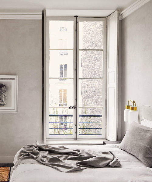 Bedroom in grey walls and lamps in brass