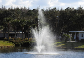 The entrance pond at Cypress Lakes Estates in Lakeland, Florida, showing the pond and surroundings.