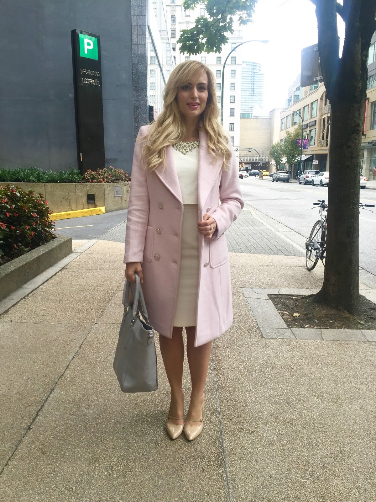 cream dress and pink winter coat