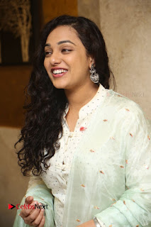 Actress Nithya Menen Latest Pictures in White Dress at 100 Days of Love Movie Audio Launch  0068.JPG