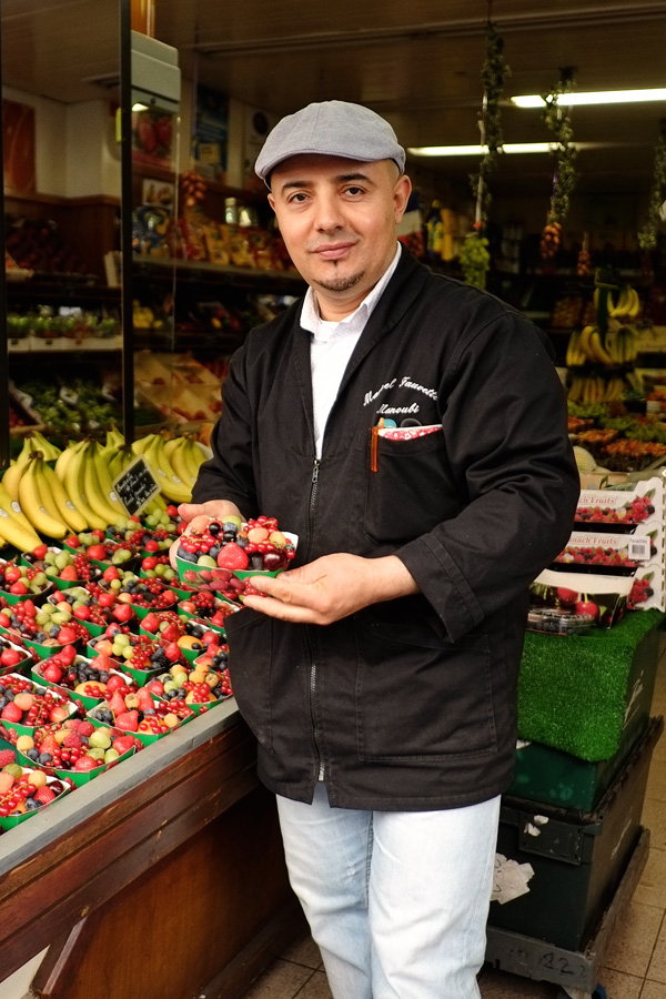 Fruit seller with punnet of wild berries on Rue Desaix, Paris. Photos by Kent Johnson for Street Fashion Sydney.