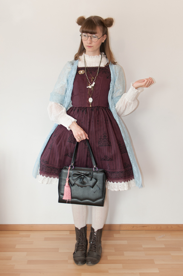 a woman posing in a witch-themed lolita fashion outfit