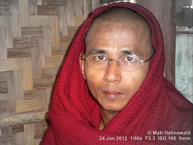 Burma, Myanmar, Bagan, Burmese man, Burmese monk, Buddhist monk, people, street portrait, headshot, focal black and white, maroon robe