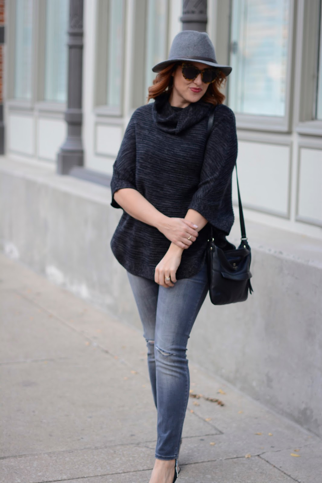 grey poncho, zara ripped jeans, kate spade black leather bag, gray fedora, sole society, karen walker sunglasses starburst