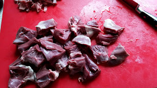 Lamb heart being prepared for cooking.