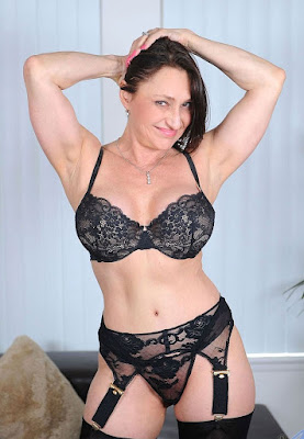 Older woman wearing black bra and panties and black stockings