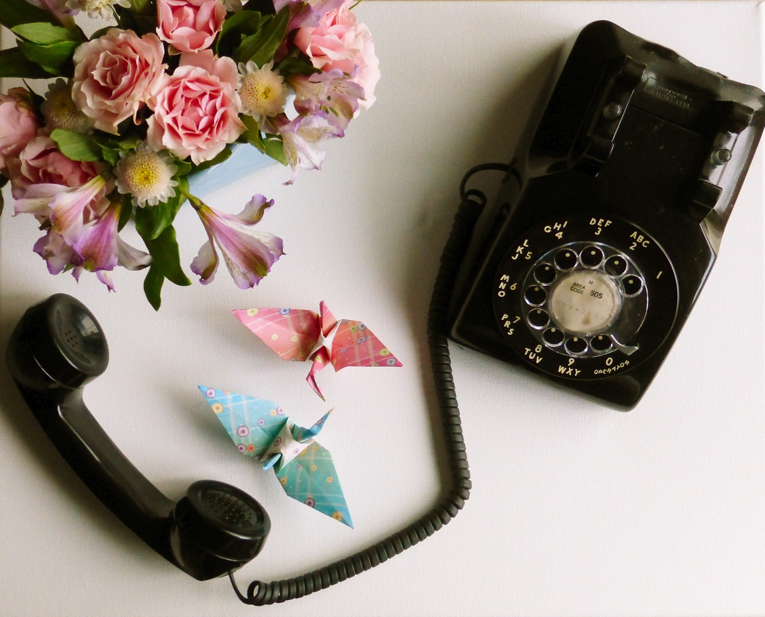 vintage telephone, vintage rotary telephone, vintage phone, vintage rotary phone, black vintage rotary dial telephone, origami birds, origami cranes, paper cranes, blue origami bird, blue origami crane, pink origami bird, pink origami crane, flowers, flower bouquet, rose bouquet, rose flower bouquet