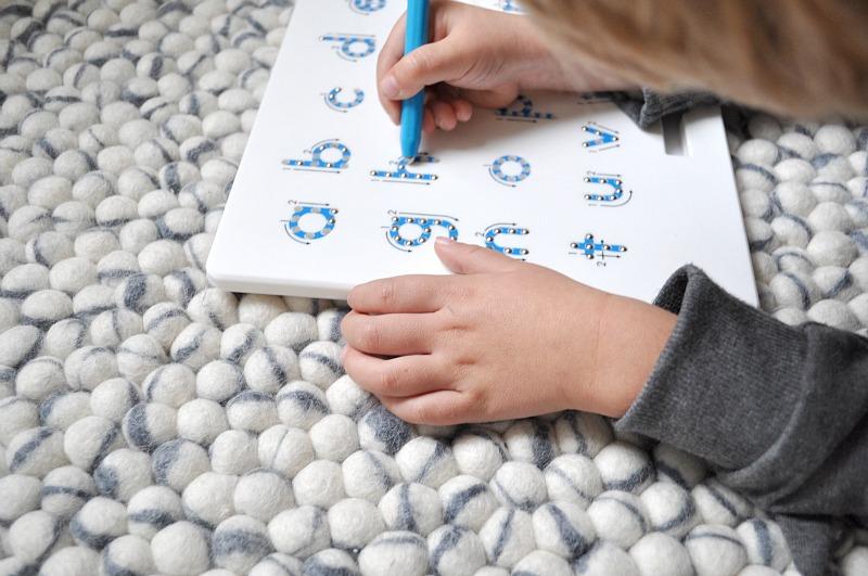 Ivory grey felt ball rug