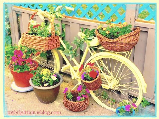 vintage yellow bike garden planter baskets flowers