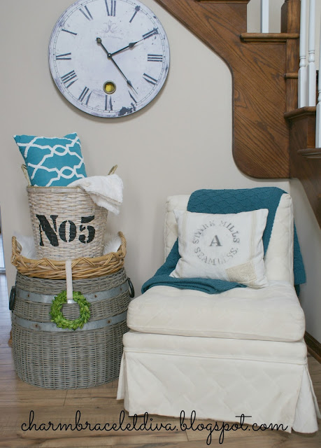 DIY stenciled basket storage for blankets and pillows