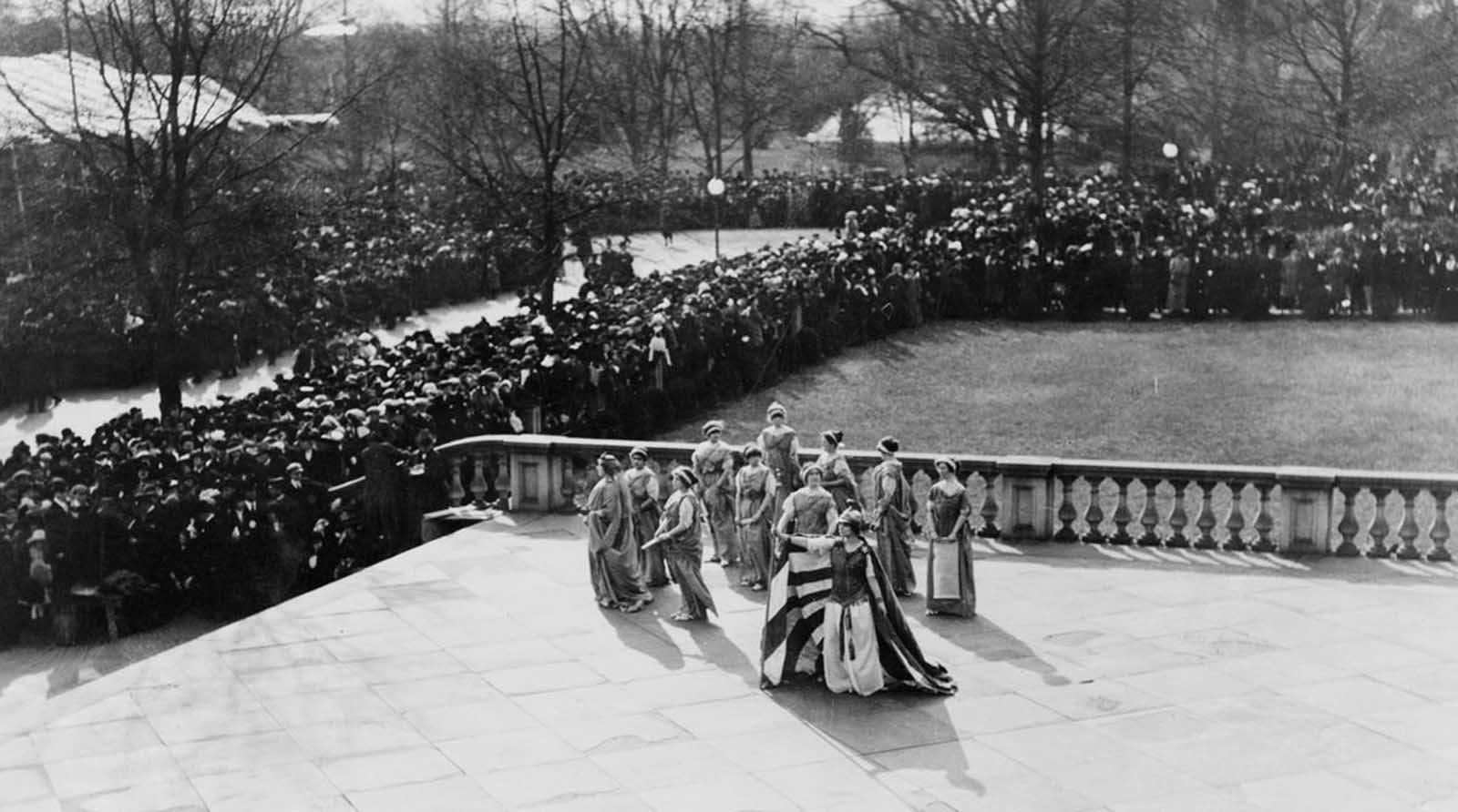 Tableau presented by the Women's Suffrage Association, on the U.S. Treasury building steps, on March 3, 1913.